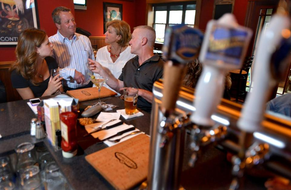 Owners Rolly Hayes and Wendy Meninno Hayes talk with customers Courtney King and Paul Goutro. Photo Credit: Josh Reynolds for The Boston Globe